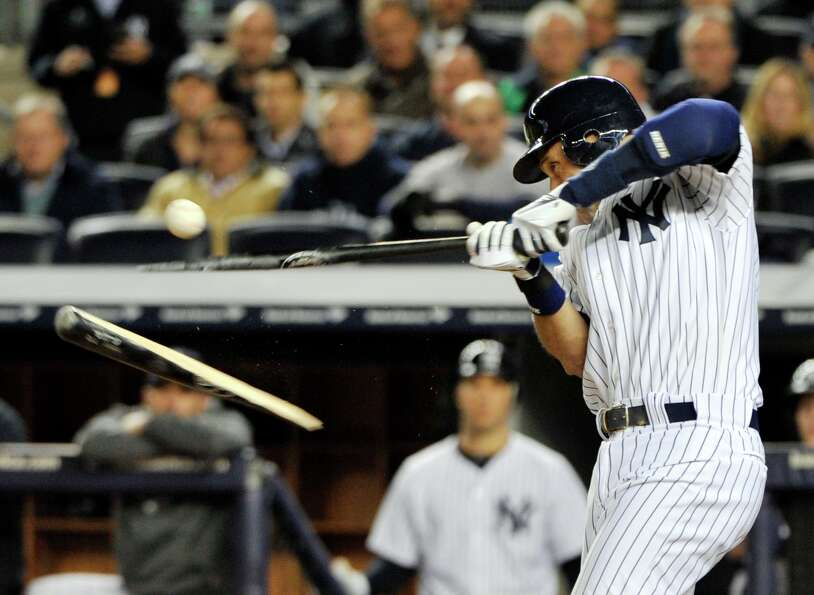 New York Yankees' Derek Jeter breaks his bat during the third inning of Game 4 of the American Leagu