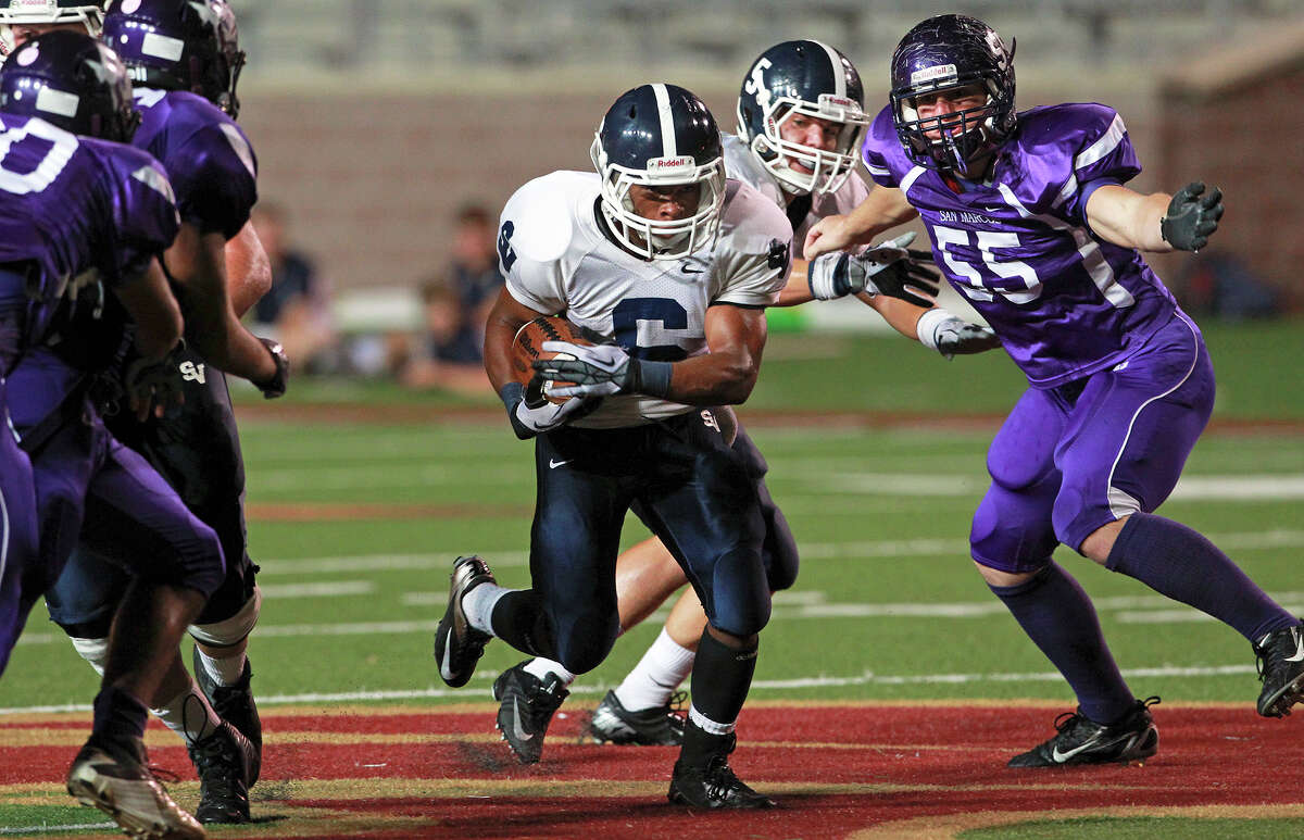 Rangers running back Xavier Coombs finds a big hole as San Marcos plays Smithson Valley at Bobcat Stadium in San Marcos on Oct. 11, 2012.