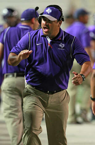 Rattlers head coach Mark Soto rallies the sideline as San Marcos plays Smithson Valley at Bobcat Stadium in San Marcos on Oct. 11, 2012. Photo: Tom Reel, San Antonio Express-News / ©2012 San Antono Express-News