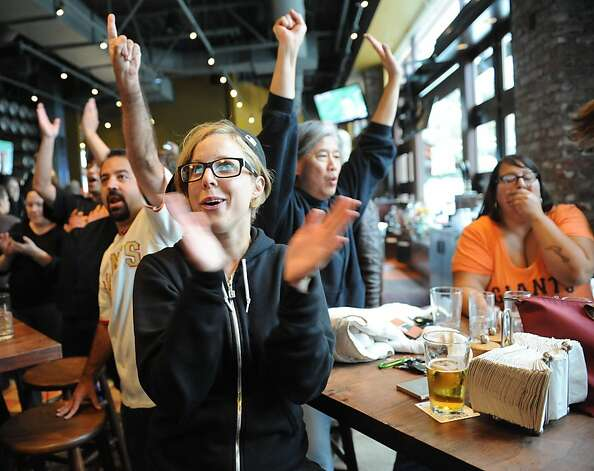 Torrey Mansur and others cheer at the Public House in San Francisco during the Giants game on October 11, 2012. The Giants eventual won the game advancing to the National League Championship Series with a 6-4 victory over the Cincinnati Reds. Photo: Susana Bates, Special To The Chronicle