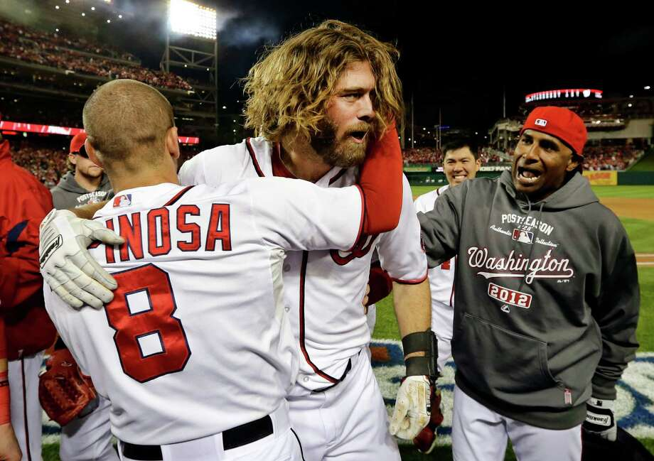 Washington Nationals' Jayson Werth, center, hugs teammate Danny Espinosa (8) after hitting the game-winning solo home run in their 2-1 win in Game 4 of the National League division baseball series against the St. Louis Cardinals on Thursday, Oct. 11, 2012, in Washington. (AP Photo/Alex Brandon) Photo: Alex Brandon