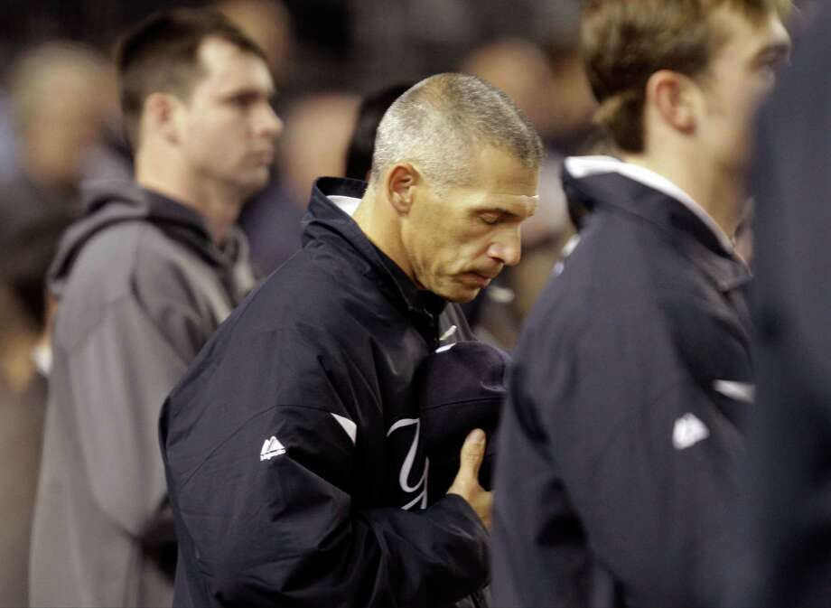 New York Yankees manager Joe Girardi pauses during a moment of silence before Game 4 of the American League division baseball series against the Baltimore Orioles Thursday, Oct. 11, 2012, in New York. Girardi's father, Jerry Girardi, who had suffered from Alzheimer's disease, died Saturday at age 81 in Metamora, Ill. (AP Photo/Kathy Willens) Photo: Kathy Willens