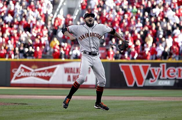 The Giants' Sergio Romo is howlingly happy after striking out Cincinnati's Scott Rolen to end the Division Series. Photo: Michael Macor, The Chronicle