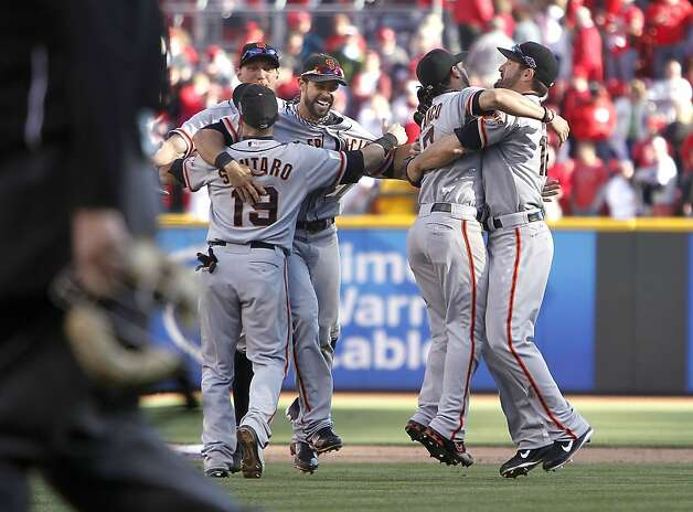 Hug it out, Giants: The team celebrates the NLDS clincher, the first of three hug-fests in 18 days. Photo: Michael Macor, The Chronicle
