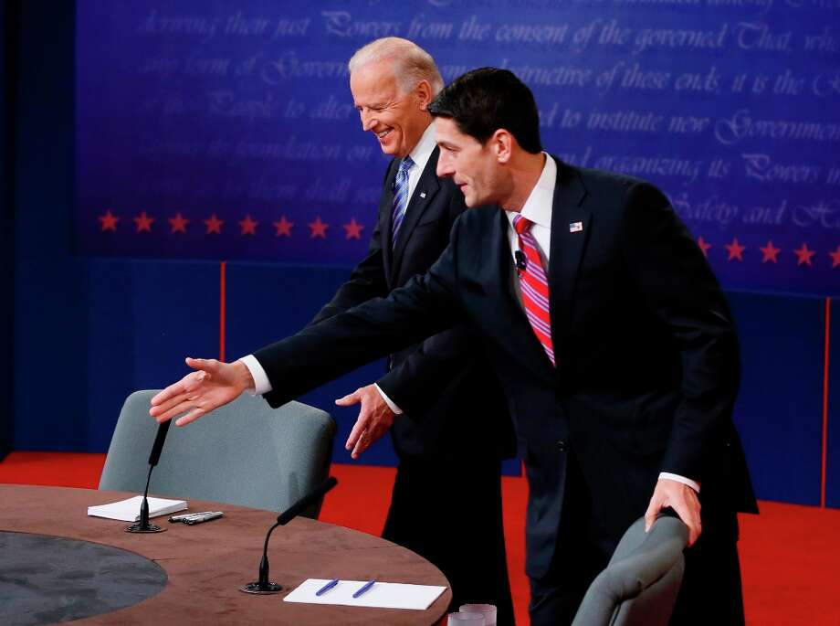 Vice President Joe Biden and Republican vice presidential nominee Rep. Paul Ryan of Wisconsin take their seats before their vice presidential debate at Centre College, Thursday, Oct. 11, 2012, in Danville, Ky. (AP Photo/Pool-Rick Wilking) Photo: Rick Wilkins, Associated Press / Reuters Pool