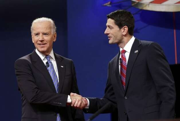 Vice President Joe Biden and Republican vice presidential candidate, Rep. Paul Ryan, R-Wis., shake hands before the start of the vice presidential debate, at Centre College in Danville, Ky., Thursday, Oct. 11, 2012. (AP Photo/Pablo Martinez Monsivais) (Associated Press)
