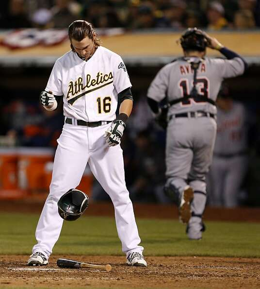 Josh Reddick drops his helmet in frustration after striking out in the seventh.
