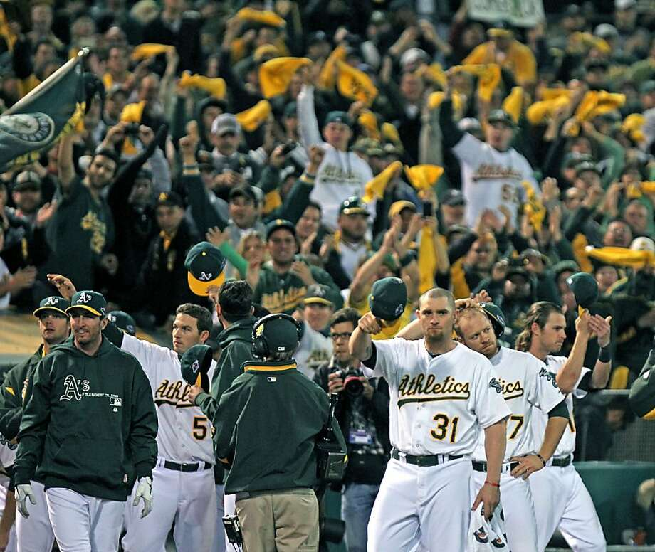 Oakland Athletics Jonny Gomes (31) and his teammates are cheered by the fans after they lost go the Detroit Tigers in their ALDS championship game Thursday October 11, 2012 in Oakland California Photo: Lance Iversen, The Chronicle
