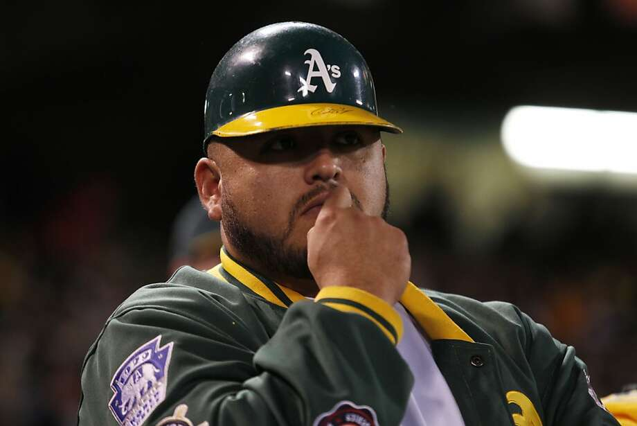 An Athletics fan looks on as the A's trail by six runs during the eighth inning of game five of the American League Divisional Series on Thursday, October 11, 2012 in Oakland, Calif. Photo: Beck Diefenbach, Special To The Chronicle