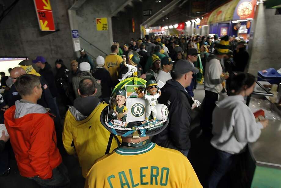 Mark Garcia of Danville wears his A's commemorative hat as he walks to his seat as the Oakland Athletics played the Detroit Tigers in game 5 of the ALDS at O.co Coliseum in Oakland, Calif. on Thursday, October 11, 2012. Photo: Carlos Avila Gonzalez, The Chronicle