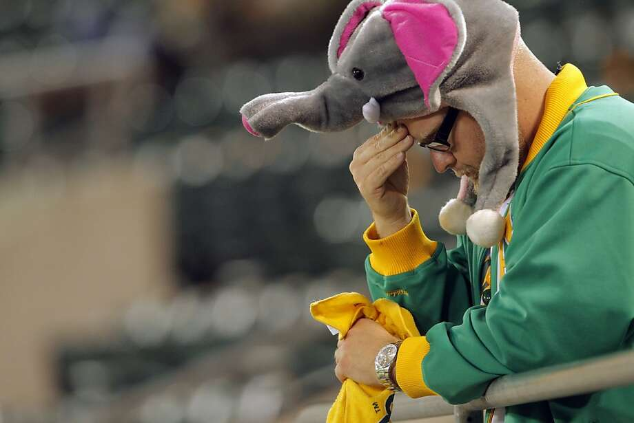 Tommy Slater of San Jose dejected after the game between the Tigers and the A's. The Oakland Athletics lost 6-0 to the Detroit Tigers in game 5 of the ALDS at O.co Coliseum in Oakland, Calif. on Thursday, October 11, 2012. Photo: Carlos Avila Gonzalez, The Chronicle