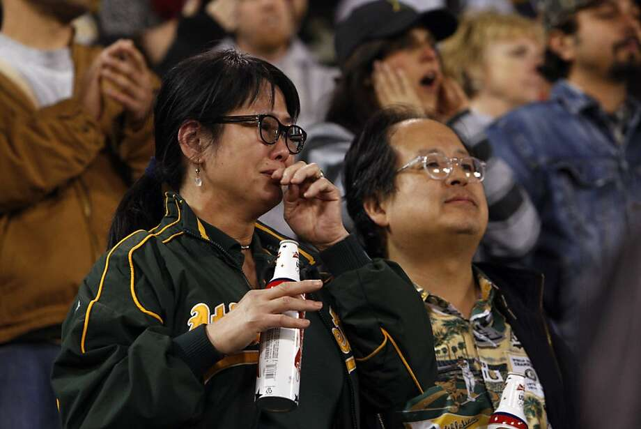 Linda Woo, left, and her husband Kim Lee, watch as the A's lose to the Detroit Tigers in Game 5. The Oakland Athletics lost 6-0 to the Detroit Tigers in game 5 of the ALDS at O.co Coliseum in Oakland, Calif. on Thursday, October 11, 2012. Photo: Carlos Avila Gonzalez, The Chronicle