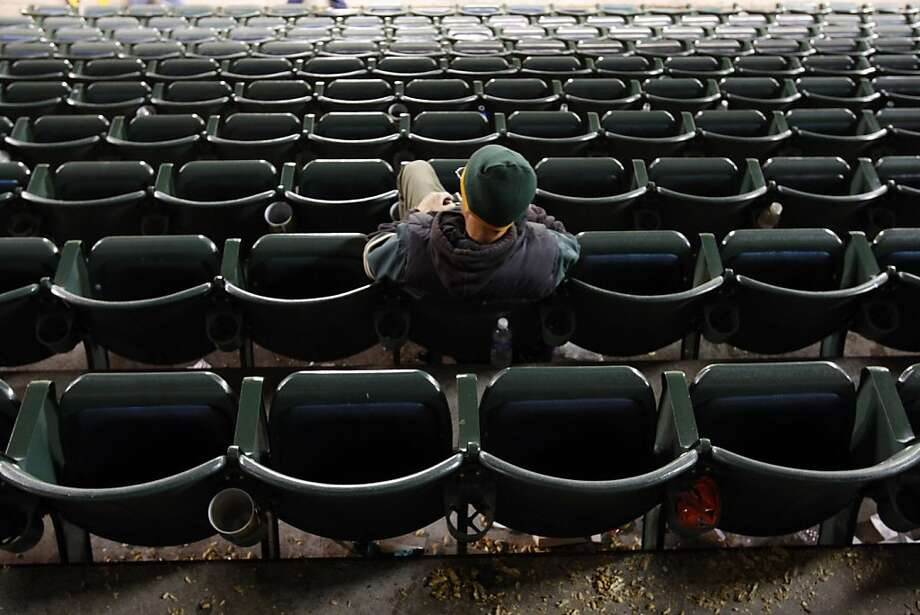 Ethan Roberts of Berkley, sits in the empty stands after the A's lost to the Detroit Tigers in Game 5. The Oakland Athletics lost 6-0 to the Detroit Tigers in game 5 of the ALDS at O.co Coliseum in Oakland, Calif. on Thursday, October 11, 2012. Photo: Carlos Avila Gonzalez, The Chronicle