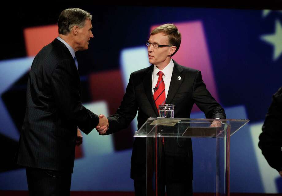 Democratic candidate for Governor Jay Inslee, left, and Republican candidate Rob McKenna, right, shake hands at the start of a debate, Thursday, Oct. 11, 2012, in Seattle. Voters will choose in November which man will replace outgoing Washington state Gov. Chris Gregoire. Photo: AP