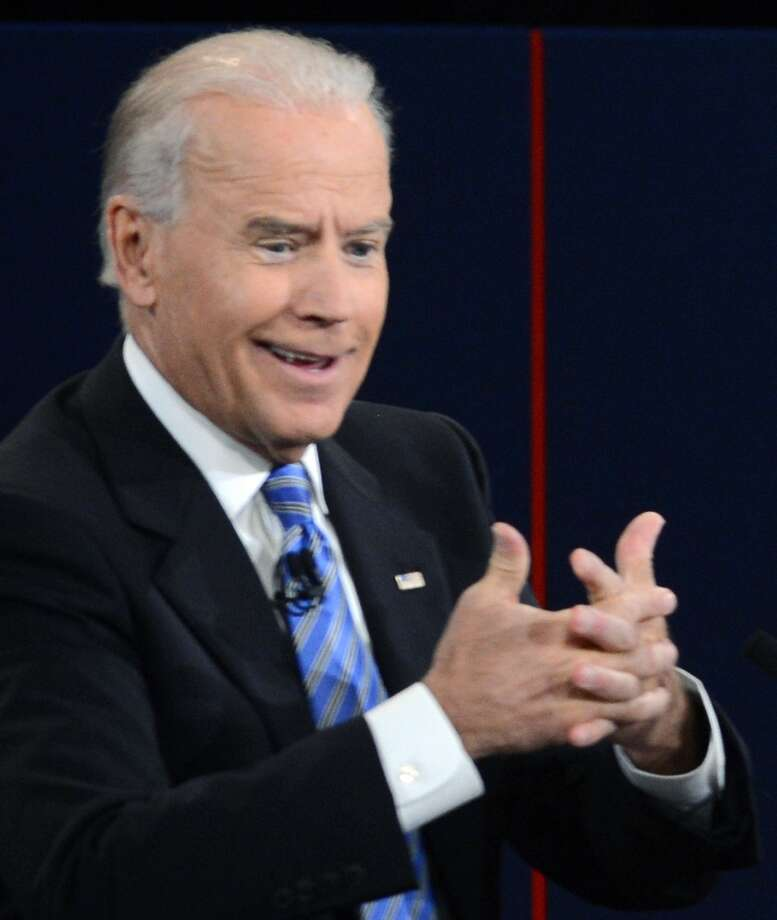 US Vice President Joe Biden participates in the vice presidential debate with Republican vice presidential candidate Paul Ryan (out of frame) at the Norton Center at Centre College in Danville, Kentucky, October 10, 2012.  AFP PHOTO / Saul LOEBSAUL LOEB/AFP/GettyImages Photo: SAUL LOEB, AFP/Getty Images / AFP