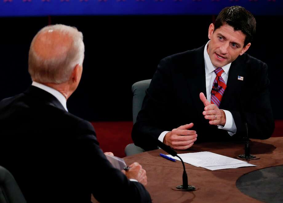 Vice President Joe Biden and Republican vice presidential nominee Rep. Paul Ryan of Wisconsin participate in the vice presidential debate at Centre College, Thursday, Oct. 11, 2012, in Danville, Ky. (AP Photo/Pool-Rick Wilking) Photo: Rick Wilkins, Associated Press / Reuters Pool