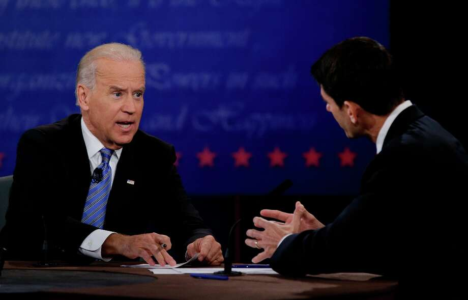 Republican vice presidential nominee Rep. Paul Ryan, of Wisconsin, right, and Vice President Joe Biden discuss a point during the vice presidential debate at Centre College, Thursday, Oct. 11, 2012, in Danville, Ky. (AP Photo/David Goldman) Photo: David Goldman, Associated Press / AP