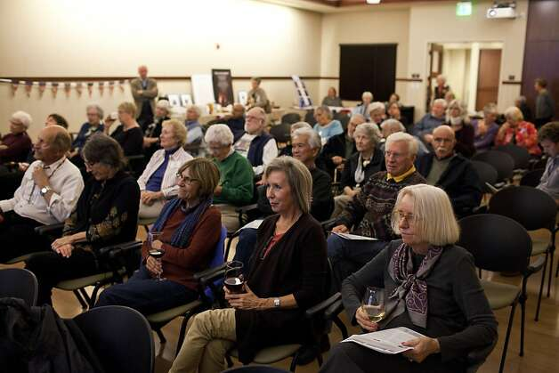 Barbara Whittingham, center, and other members of the Rossmoor Democratic Club watch the Vice Presidential debate at the Creekside Country Club in Rossmoor, Calif., Thursday, October 11, 2012. Photo: Jason Henry, Special To The Chronicle
