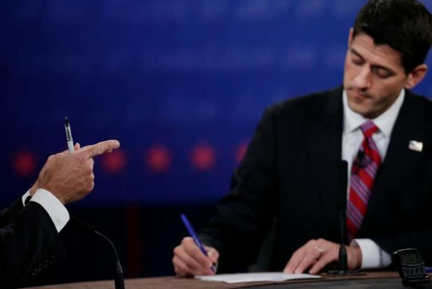 Republican vice presidential nominee Rep. Paul Ryan, of Wisconsin, right, takes notes as Vice Presid