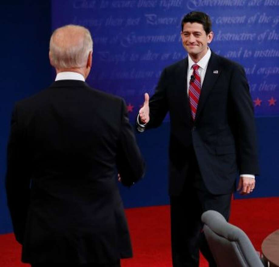 Vice President Joe Biden and Republican vice presidential nominee Rep. Paul Ryan of Wisconsin shake hands before their vice presidential debate at Centre College, Thursday, Oct. 11, 2012, in Danville, Ky. (AP Photo/Pool-Rick Wilking) (Associated Press)
