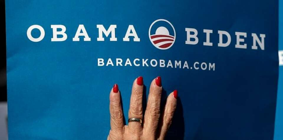 A supporters holds a sign for President Barack Obama and Vice President Joe Biden at Centre College,