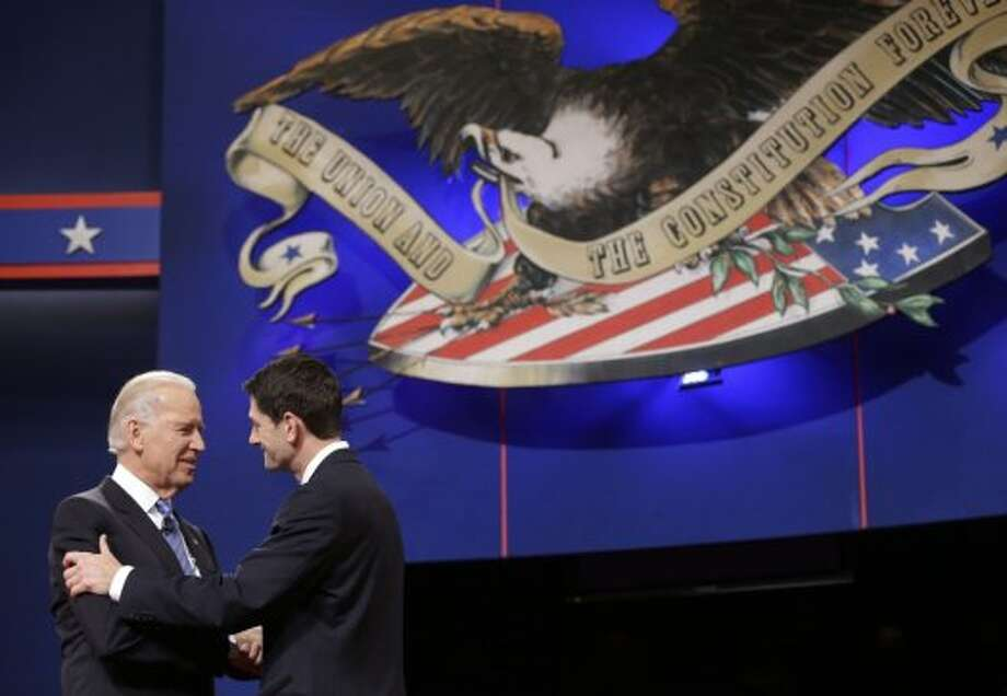 Vice President Joe Biden and Republican vice presidential candidate, Rep. Paul Ryan, R-Wis., shake hands before the start of the vice presidential debate, at Centre College in Danville, Ky., Thursday, Oct. 11, 2012. (AP Photo/Pablo Martinez Monsivais) (AP)
