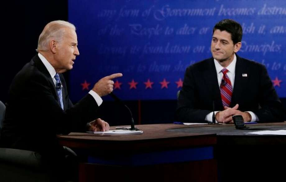 Republican vice presidential nominee Rep. Paul Ryan of Wisconsin, right, listens as Vice President Joe Biden makes a point during the vice presidential debate at Centre College, Thursday, Oct. 11, 2012, in Danville, Ky. (AP Photo/Eric Gay) (Associated Press)