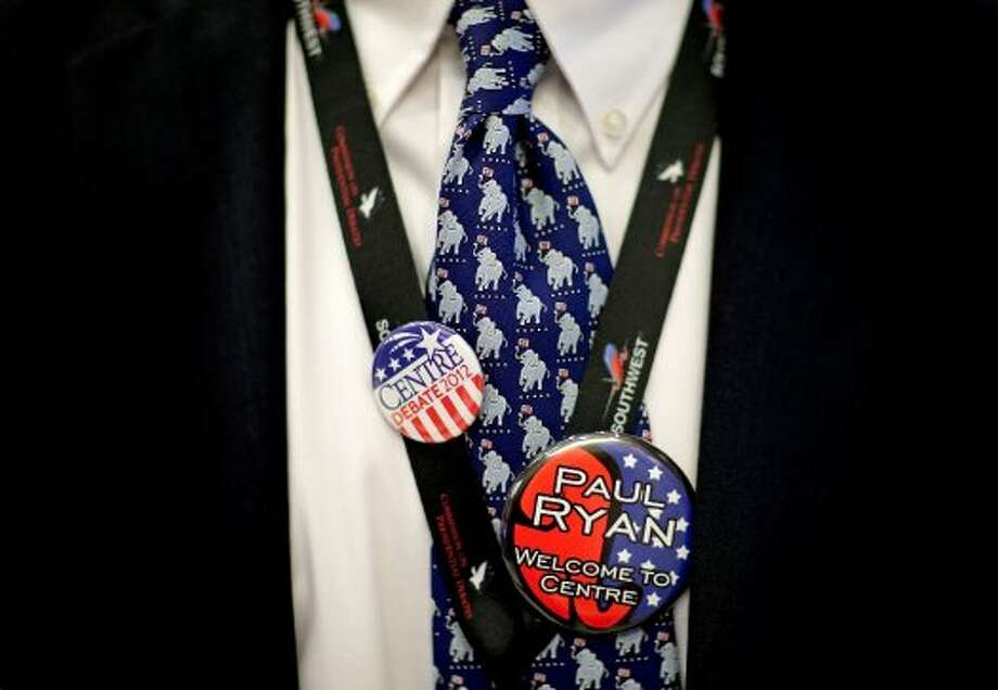 Campaign volunteer Hunt VanderToll wears a tie and button in support of the Republican party, and Republican vice presidential candidate, Rep. Paul Ryan, R-Wis., ahead of the vice presidential debate between Ryan and Vice President Joe Biden, Thursday, Oct. 11, 2012, at Centre College in Danville, Ky. (AP Photo/David Goldman) (ASSOCIATED PRESS)