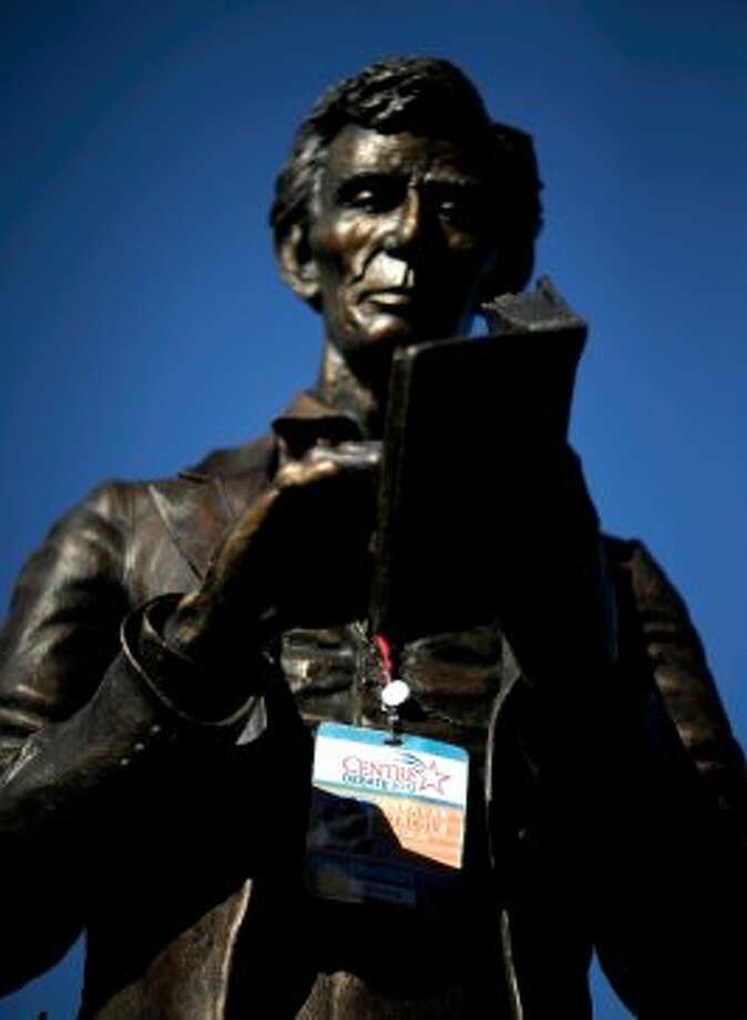 A personalized Abraham Lincoln credential  for Thursday's vice presidential debate hangs on a statue of Lincoln, Wednesday, Oct. 10, 2012, at Centre College in Danville, Ky. (AP Photo/David Goldman) (ASSOCIATED PRESS)