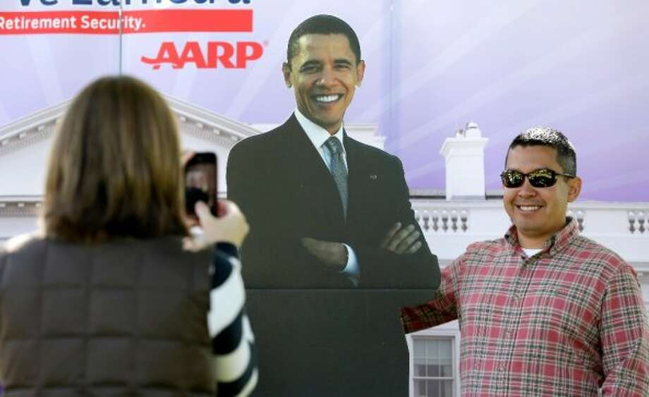 Chris Herron of Danville, Kentucky, right, has his picture taken with a cutout of President Barack Obama outside the Norton Center on the Centre College campus before the vice presidential debate, Thursday, Oct. 11, 2012, in Danville, Kentucky. Vice President Joe Biden will face Republican vice presidential candidate, Rep. Paul Ryan, R-Wis., in Thursday's debate. (AP Photo/Charlie Neibergall) (ASSOCIATED PRESS)