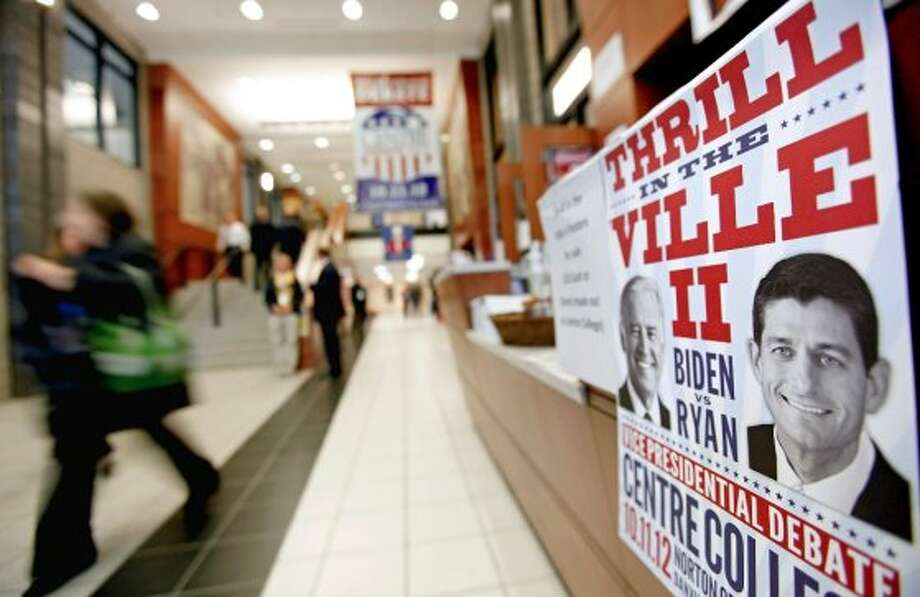 A poster advertising the vice presidential debate between Republican vice presidential candidate, Rep. Paul Ryan, R-Wis., and Vice President Joe Biden, is posted in the media center, Thursday, Oct. 11, 2012, at Centre College in Danville, Ky. (AP Photo/David Goldman) (ASSOCIATED PRESS)