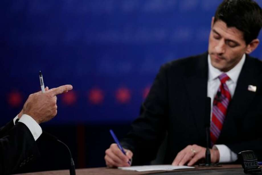 Republican vice presidential nominee Rep. Paul Ryan, of Wisconsin, right, takes notes as Vice President Joe Biden makes a point during the vice presidential debate at Centre College, Thursday, Oct. 11, 2012, in Danville, Ky. (AP Photo/Eric Gay) (AP)