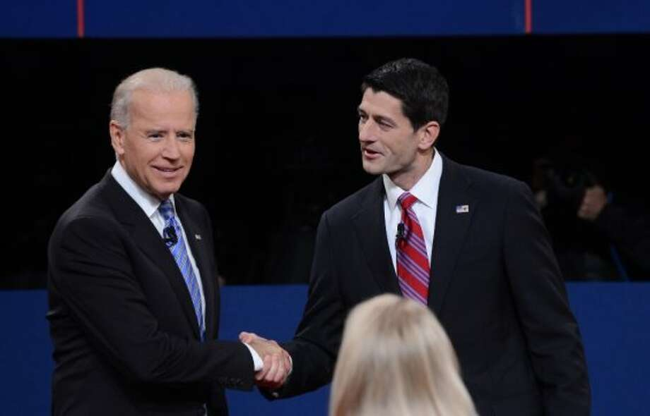 US Vice President Joe Biden (L) and Republican vice presidential candidate Paul Ryan (R) arrive on stage for their  vice presidential debate at the Norton Center at Centre College in Danville, Kentucky, October 10, 2012, moderated by Martha Raddatz (C) of ABC News.  AFP PHOTO / Saul LOEBSAUL LOEB/AFP/GettyImages (AFP/Getty Images)