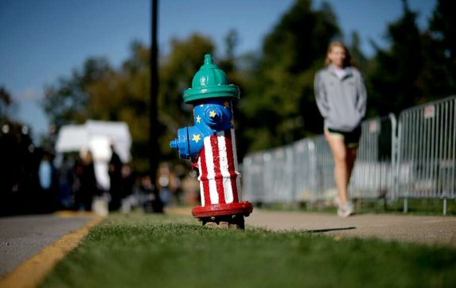 A fire hydrant is decorated to resemble the American flag as part of a project to paint 75 hydrants on the campus of Centre College ahead of Thursday's vice presidential debate, Wednesday, Oct. 10, 2012, in Danville, Ky. (AP Photo/David Goldman) (ASSOCIATED PRESS)