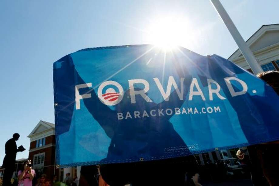 Supporters hold an President Barack Obama banner at Centre College, site of the Vice Presidential debate, Thursday, Oct. 11, 2012, in Danville, Ky. Vice President Joe Biden will face Republican vice presidential candidate, Rep. Paul Ryan, R-Wis., Thursday. (AP Photo/Eric Gay) (ASSOCIATED PRESS)