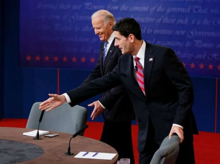 Vice President Joe Biden and Republican vice presidential nominee Rep. Paul Ryan of Wisconsin take their seats before their vice presidential debate at Centre College, Thursday, Oct. 11, 2012, in Danville, Ky. (AP Photo/Pool-Rick Wilking) (Associated Press)