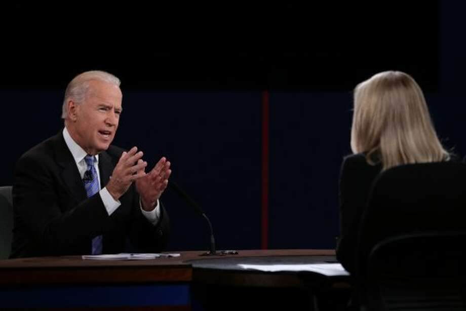 "U.S. Vice President Joseph ""Joe"" Biden, left, gestures as he speaks during a debate with Representative Paul Ryan, Republican vice presidential candidate, unseen, in front of moderator Martha Raddatz of ABC News before the start of a debate in Danville, Kentucky, U.S., on Thursday, Oct. 11, 2012. Ryan said President Barack Obama is presiding over a ""chaotic"" foreign policy that is ""unraveling'' and making the US. ""less safe,"" as he began his debate tonight with Joe Biden. Photographer: Scott Eells/Bloomberg *** Local Caption *** Joe Biden; Martha Raddatz (Bloomberg)"