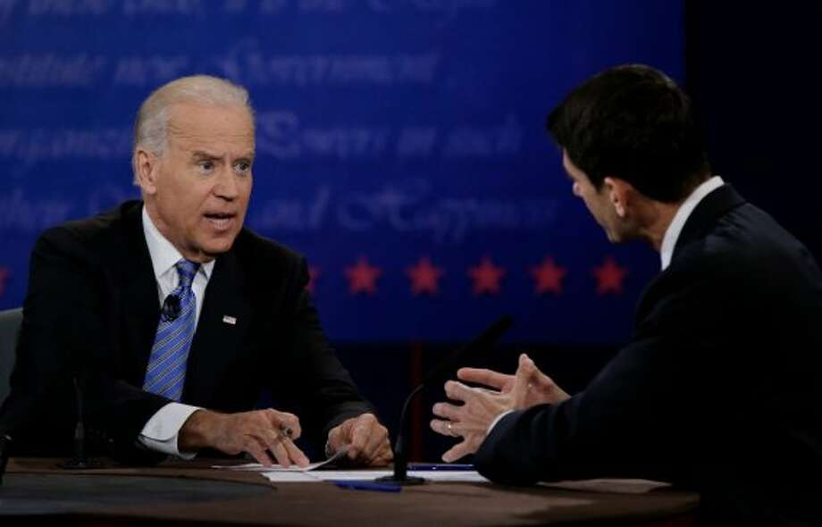 Republican vice presidential nominee Rep. Paul Ryan, of Wisconsin, right, and Vice President Joe Biden discuss a point during the vice presidential debate at Centre College, Thursday, Oct. 11, 2012, in Danville, Ky. (AP Photo/David Goldman) (Associated Press)