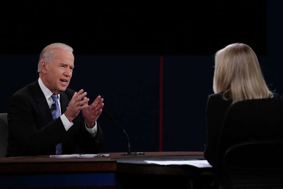 "U.S. Vice President Joseph ""Joe"" Biden, left, gestures as he speaks during a debate with Representative Paul Ryan, Republican vice presidential candidate, unseen, in front of moderator Martha Raddatz of ABC News before the start of a debate in Danville, Kentucky, U.S., on Thursday, Oct. 11, 2012. Ryan said President Barack Obama is presiding over a ""chaotic"" foreign policy that is ""unraveling'' and making the US. ""less safe,"" as he began his debate tonight with Joe Biden. Photographer: Scott Eells/Bloomberg *** Local Caption *** Joe Biden; Martha Raddatz Photo: Scott Eells, Bloomberg / © 2012 Bloomberg Finance LP"
