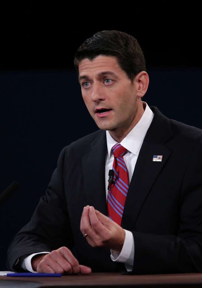 "Representative Paul Ryan, Republican vice presidential candidate, gestures as he speaks during a debate with U.S. Vice President Joseph ""Joe"" Biden, unseen, in Danville, Kentucky, U.S., on Thursday, Oct. 11, 2012. Ryan said President Barack Obama is presiding over a ""chaotic"" foreign policy that is ""unraveling'' and making the US. ""less safe,"" as he began his debate tonight with Joe Biden. Photographer: Scott Eells/Bloomberg *** Local Caption *** Paul Ryan Photo: Scott Eells, Bloomberg / © 2012 Bloomberg Finance LP"