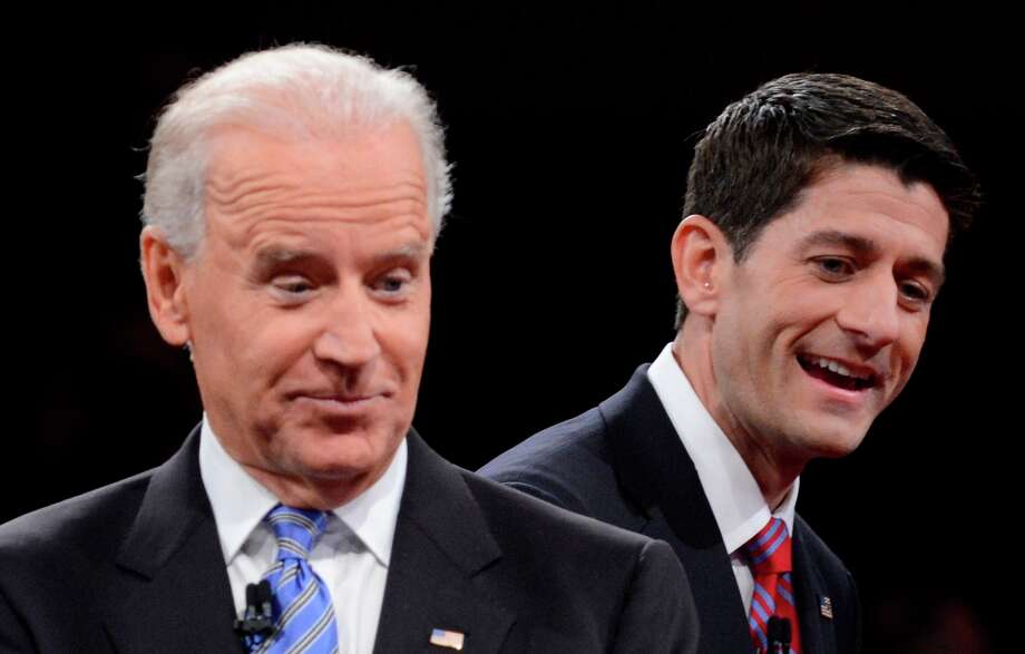Vice President Joe Biden and Republican vice presidential nominee Rep. Paul Ryan of Wisconsin gesture after the vice presidential debate at Centre College, Thursday, Oct. 11, 2012, in Danville, Ky. (AP Photo/Pool-Michael Reynolds) Photo: Michael Reynolds, Associated Press / EPA Pool