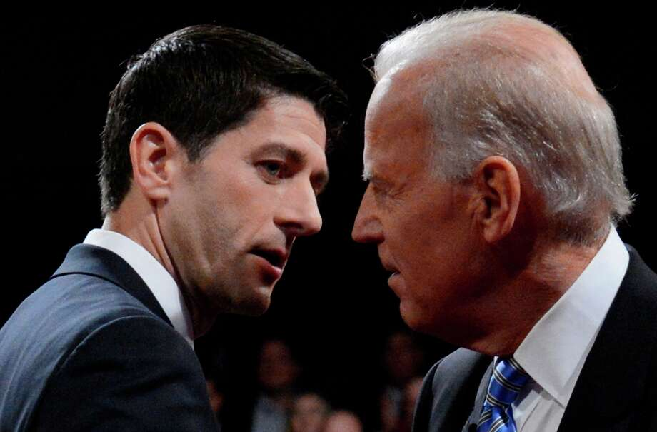 Vice President Joe Biden and Republican vice presidential nominee Rep. Paul Ryan of Wisconsin shake hands after the vice presidential debate at Centre College, Thursday, Oct. 11, 2012, in Danville, Ky. (AP Photo/Pool-Michael Reynolds) Photo: Michael Reynolds, Associated Press / EPA Pool