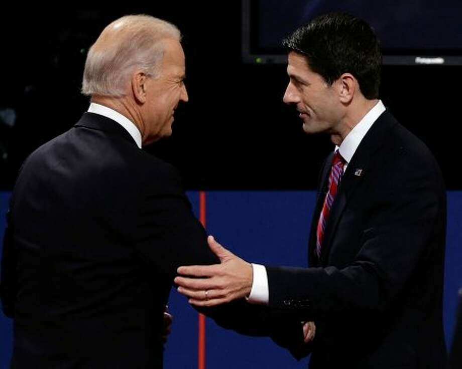 Vice President Joe Biden and Republican vice presidential nominee Rep. Paul Ryan of Wisconsin shake hands after the vice presidential debate at Centre College, Thursday, Oct. 11, 2012, in Danville, Ky. (AP Photo/Charlie Neibergall) (Associated Press)