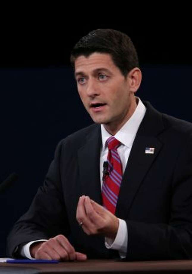 "Representative Paul Ryan, Republican vice presidential candidate, gestures as he speaks during a debate with U.S. Vice President Joseph ""Joe"" Biden, unseen, in Danville, Kentucky, U.S., on Thursday, Oct. 11, 2012. Ryan said President Barack Obama is presiding over a ""chaotic"" foreign policy that is ""unraveling'' and making the US. ""less safe,"" as he began his debate tonight with Joe Biden. Photographer: Scott Eells/Bloomberg *** Local Caption *** Paul Ryan (Bloomberg)"