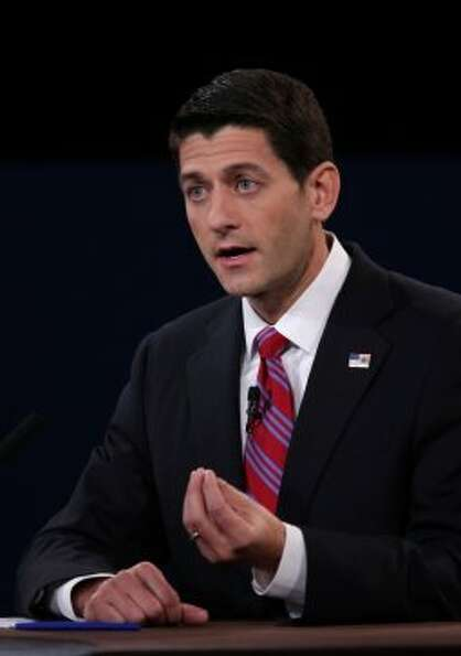 Representative Paul Ryan, Republican vice presidential candidate, gestures as he speaks during a deb