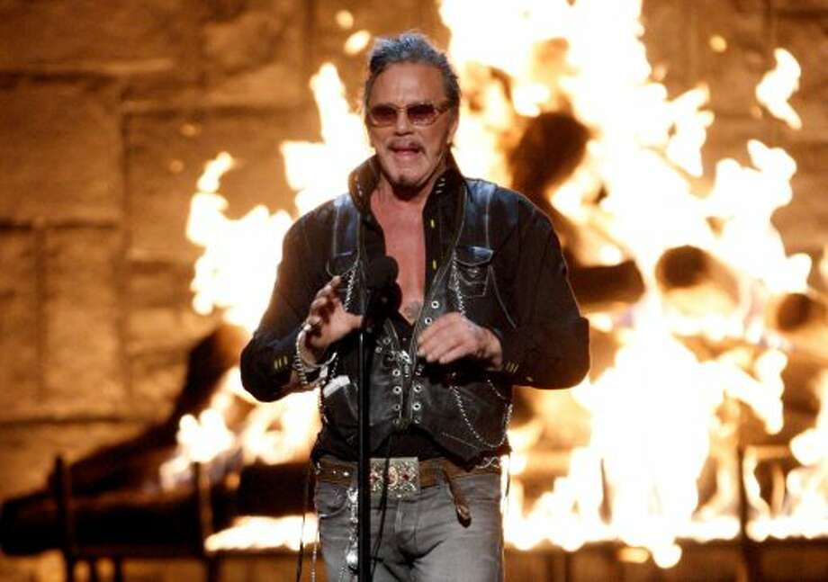 Second opinion: Rocking leather vest. It'll be hell if it gets wet, but what better to wear as civilization crumbles? Pictured above with Mickey Rourke.(Photo by Kevin Winter/Getty Images) (Getty Images)