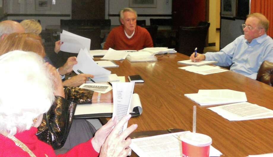 Lou Gagliano, center, the chairman of the Downtown 2020 Committee, discusses a master plan for downtown development Thursday with the Representative Town Meeting's Long Range Planning Committee. Photo: Paul Schott / Westport News