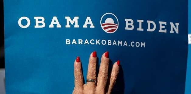 A supporters holds a sign for President Barack Obama and Vice President Joe Biden at Centre College, site of the Vice Presidential debate, Thursday, Oct. 11, 2012, in Danville, Ky. Vice President Joe Biden will face Republican vice presidential candidate, Rep. Paul Ryan, R-Wis., Thursday. (AP Photo/Eric Gay) (ASSOCIATED PRESS)