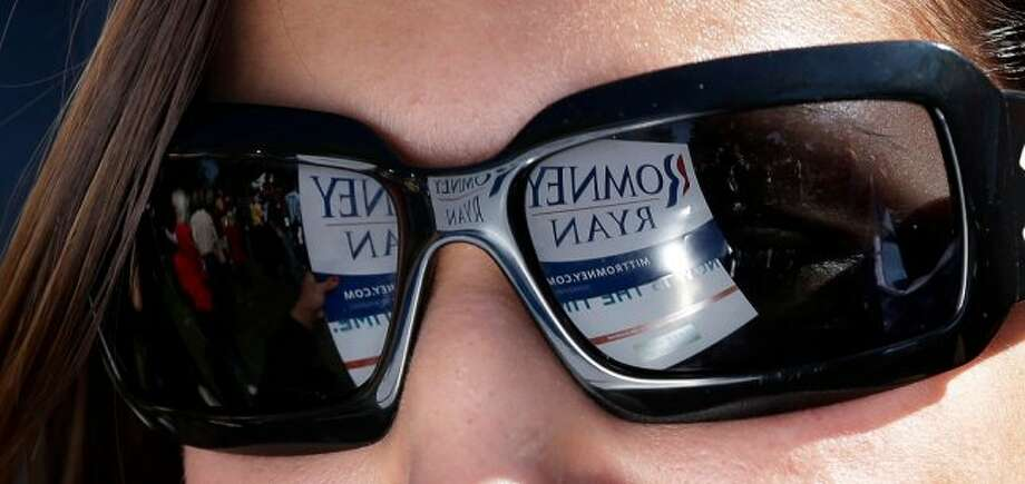 A sign for Republican presidential candidate, former Massachusetts Gov. Mitt Romney  is reflected in a supporters sunglasses at Centre College, site of the Vice Presidential debate, Thursday, Oct. 11, 2012, in Danville, Ky. Vice President Joe Biden will face Republican vice presidential candidate, Rep. Paul Ryan, R-Wis., Thursday. (AP Photo/Eric Gay) (ASSOCIATED PRESS)
