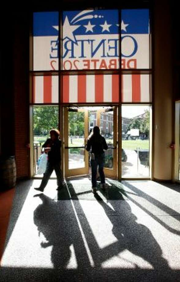 Workers enter the Norton Center for the Arts in preparation for the vice presidential debate at Centre College, Wednesday, Oct. 10, 2012, in Danville, Ky. Vice president Joe Biden will face Republican vice presidential candidate, Rep. Paul Ryan, R-Wis., Thursday. (AP Photo/Mark Humphrey) (ASSOCIATED PRESS)